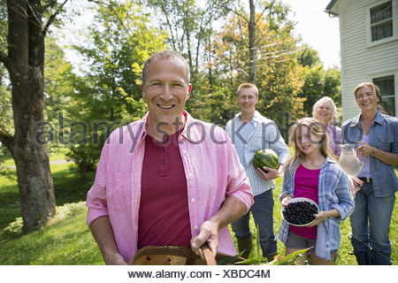 A family summer garing at a farm. A shared meal a homecoming. - Stock Photo