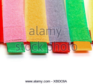 Pack of Colorful Velcro Strips, on white background - Stock Photo