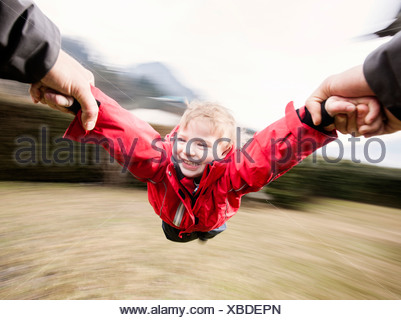 Father letting his son 'fly' - Stock Photo