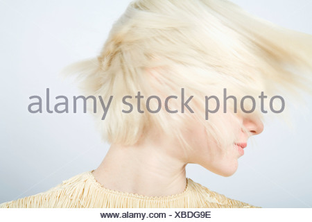 A young woman shaking her hair - Stock Photo