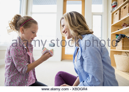 Mother and daughter with origami fortune teller Stock Photo