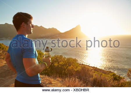 Young man contemplating after jogging - Stock Photo