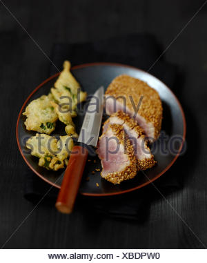 Japanese-style tuna coated in sesame seeds,broccoli tempuras - Stock Photo