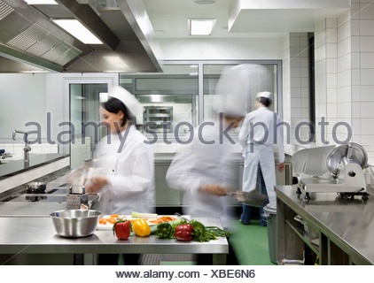 A busy commercial kitchen - Stock Photo