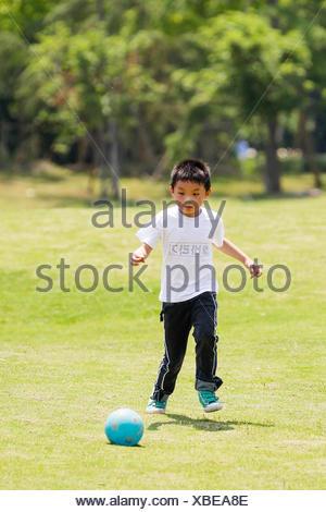Little football player (6-7) - Stock Photo