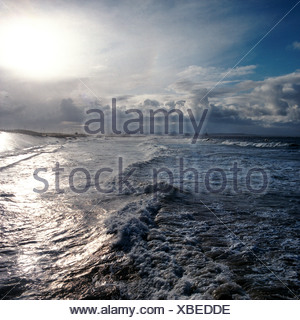 England. Yorkshire. Stormy sky over sea with industrial coastline. - Stock Photo