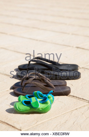 Bathing shoes in a row - Stock Photo