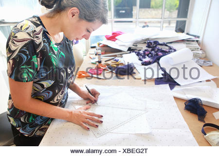 Designer at work in studio - Stock Photo