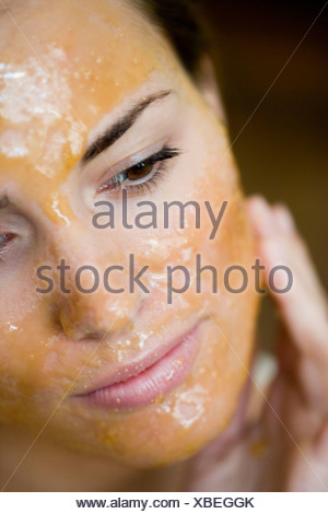 young woman with chocolate-mask closeup - Stock Photo