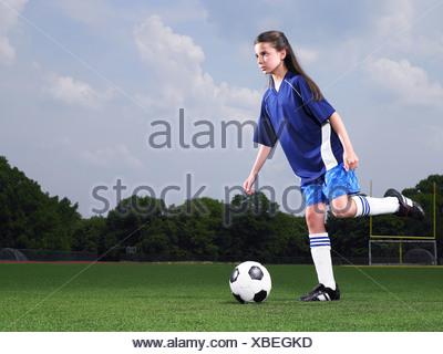 A footballer about to kick a football - Stock Photo