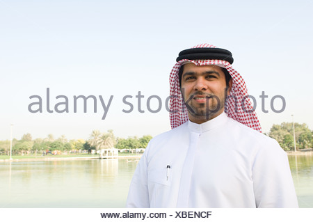 Portrait of a young man wearing a gutra - Stock Photo