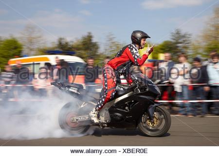 Motorcycle stuntman Mike Auffenberg showing a burnout, Koblenz, Rhineland-Palatinate, Germany, Europe - Stock Photo