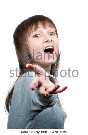 Young beautiful girl sings - Stock Photo