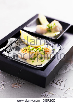 Close-up of scallop with lime slice