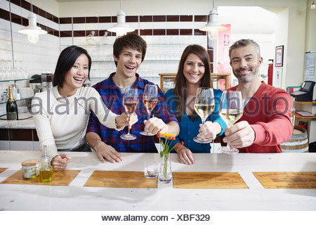 Germany, Cologne, Man and woman having wine, smiling, portrait - Stock Photo