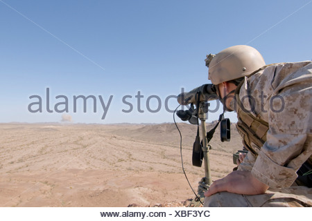 Marine Forward Air Controller Looks At Laser Guided Bomb Strike - Stock Photo