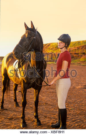 Young girl and horse, Canoe Cove beach, Prince Edward Island, Canada, model released - Stock Photo