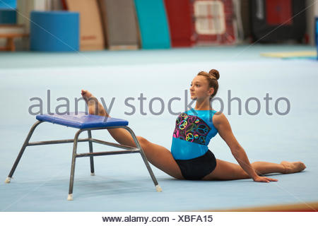 Young gymnast practising moves - Stock Photo