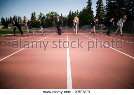 Business-people on a racetrack - Stock Photo
