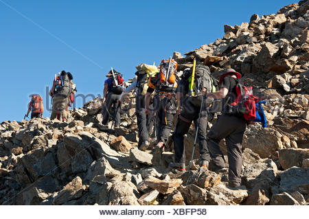 Alpinists during the ascent of Mont Blanc along the regular route via Gouter Hut, Chamonix, Haute Savoie, France, Europe - Stock Photo