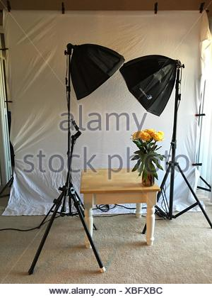 Flower Vase On Table At Photo Studio - Stock Photo