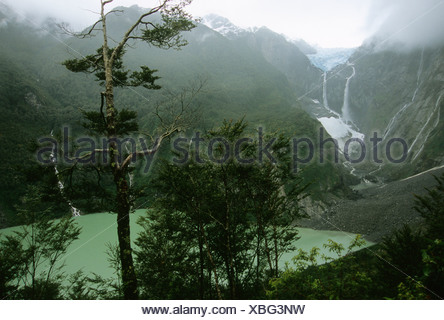 Waterfalls cascade from a hanging glacier in Queulat National Park, Southern Chile - Stock Photo