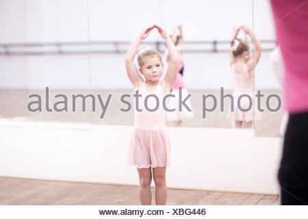 Young ballerinas posing in dance studio - Stock Photo