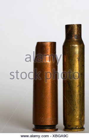 Bullet casings of the AK-47 and M-16 - Stock Photo