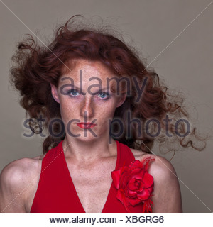 Freiburg, Germany, young red-haired woman with freckles - Stock Photo