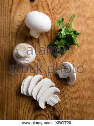 sliced white champignon mushrooms - Stock Photo