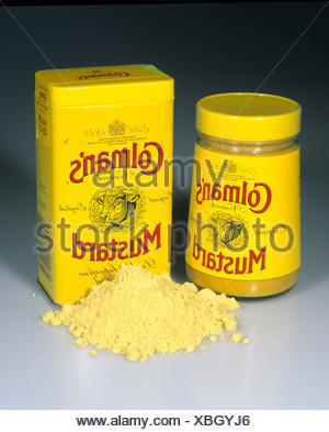 Colmans original English mustard powder and tin and preprepared mustard in a bottle - Stock Photo