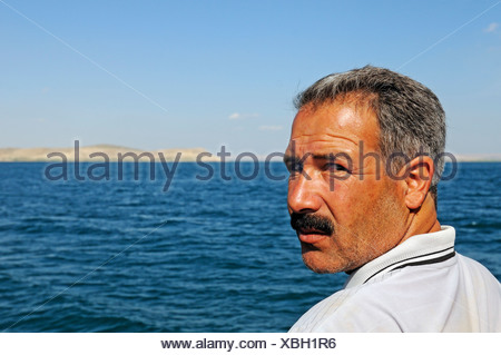 Fisherman on the Asad reservoir of the Euphrates, Syria, Asia - Stock Photo