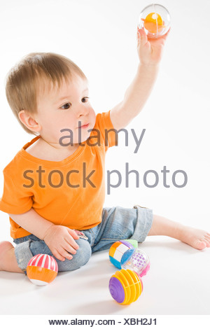 baby boy playing with balls - Stock Photo