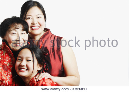 Portrait of a mother with her daughter and granddaughter smiling - Stock Photo