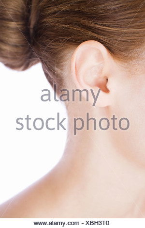 A young woman's ear, close-up - Stock Photo