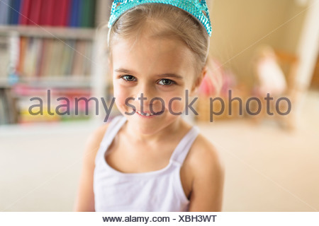 Portrait of cute young girl in princess crown - Stock Photo