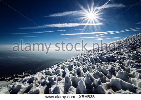 Sun and snow on mountain, Mount Adams, Washington State, America, USA - Stock Photo