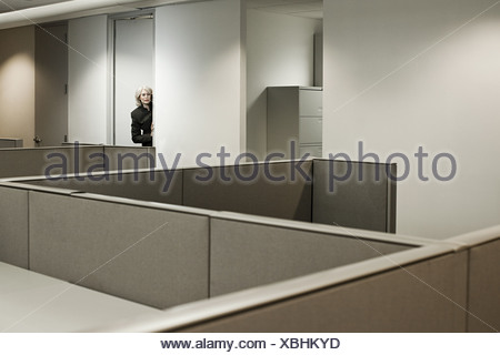 Businesswoman hiding in office - Stock Photo