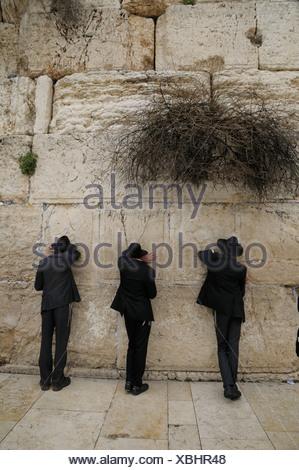 Orthodox Jews praying, Western Wall or Wailing Wall, Jerusalem, Israel, Middle East - Stock Photo