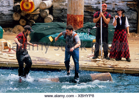 Lumberjacks compete in the log rolling competition during the Great Alaskan Lumberjack Show in Ketchikan in Southeast, Alaska - Stock Photo