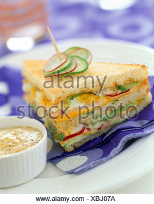 raw vegetable club sandwich with mustard - Stock Photo
