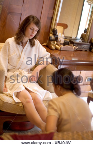Sitting in a chair, feet under chair, close up Stock Photo ...
