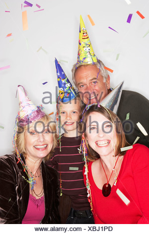 3 generation family in party hats