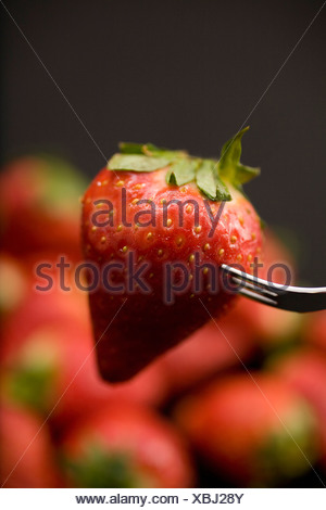 Strawberry on fork - Stock Photo