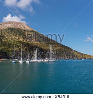 Sailing ships at anchor near the volcano Gran Cratere - Stock Photo
