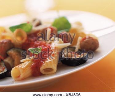 Pasta with minced meat balls and aubergines (Tortiglioni alla siciliana) - Stock Photo
