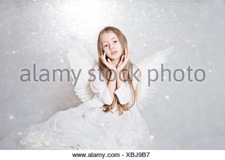 Portrait of a Girl wearing angel wings - Stock Photo