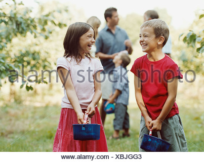 Family having fun in an orchard - Stock Photo