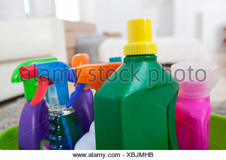 Plastic Bottles On Yellow Background; Colourful Cleaning Product Plastic  Bottles And Sprays On Kitchen Counter   Stock Photo