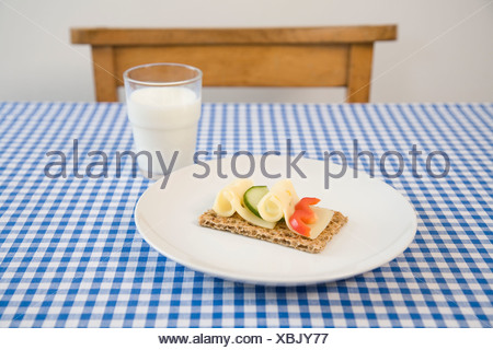 Crisp bread with cheese, glass of milk - Stock Photo